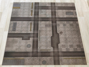 Cityscape battle mat laid out on the floor