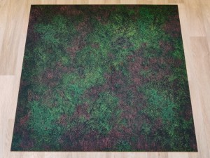 Forest battle mat laid out on the floor